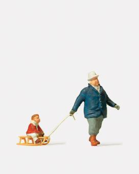 Preiser Mann mit Kind auf Schlitten 28078